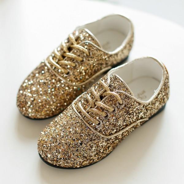 Детские золотые туфли